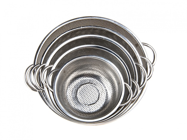 Top view of group metal colander on a white isolated background. kitchen accessories.