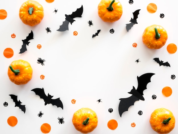 Top view halloween concept with pumpkins and bats
