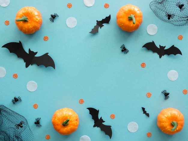 Top view halloween concept with pumpkins
