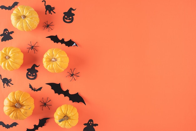 Top view of halloween crafts on orange background with copyspace