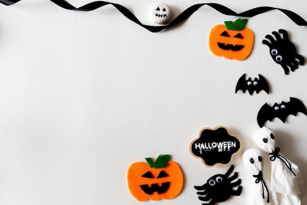 Top view of halloween crafts on white background with copy space