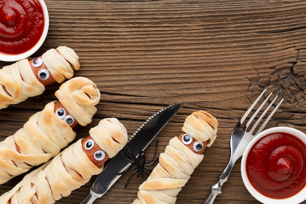 Top view halloween food ketchup and cutlery