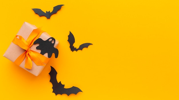 Top view halloween present and bats with copy space