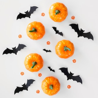 Top view halloween pumpkins and bats