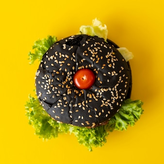 Top view hamburger with yellow background