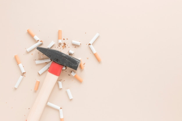 Top view hammer with cigarettes