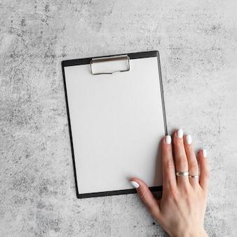 Top view of hand over empty menu