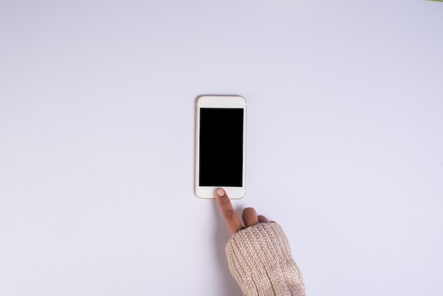 Top view hand holding cell phone on white background