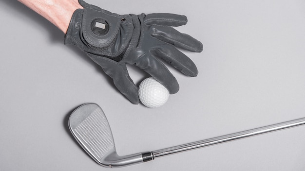 Top view hand with golf ball