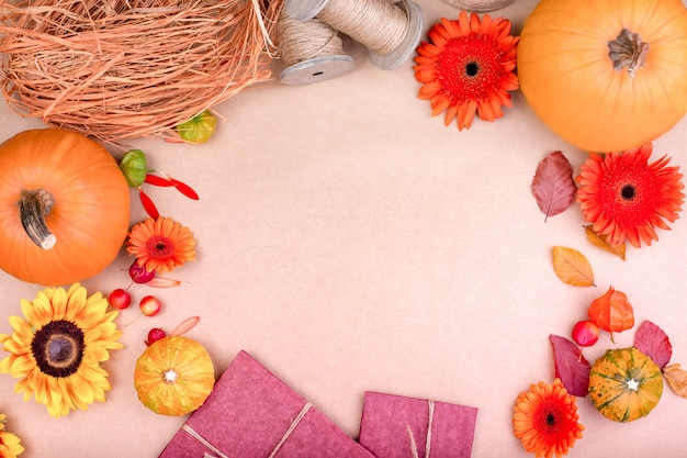 Top view of handcraft gift box, yellow and orange flowers and pumpkins on rose