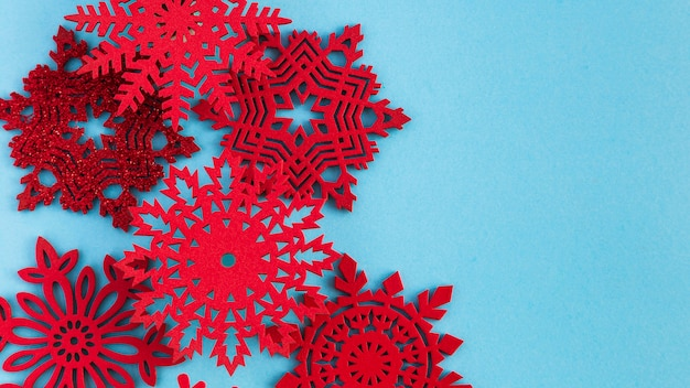 Top view handmade red snowflakes