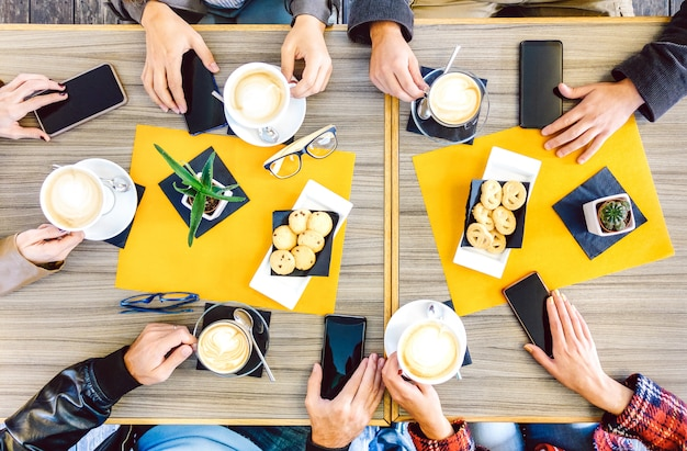Top view of hands drinking at coffee shop