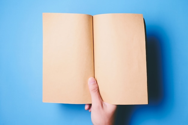 Top view of hands holding a blank book ready