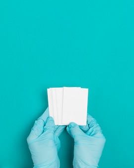 Top view hands holding envelopes with copy space