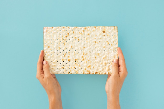 Top view of hands holding jewish cracker