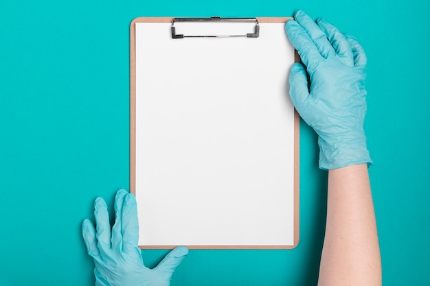 Top view hands holding medical clipboard