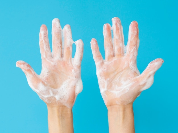 Top view of hands with foam from soap