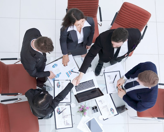 Top view.handshake of colleagues after discussing a new financial project.