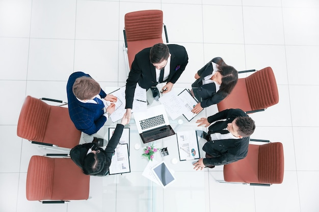 Top view.handshake of commercial partners. business concept.