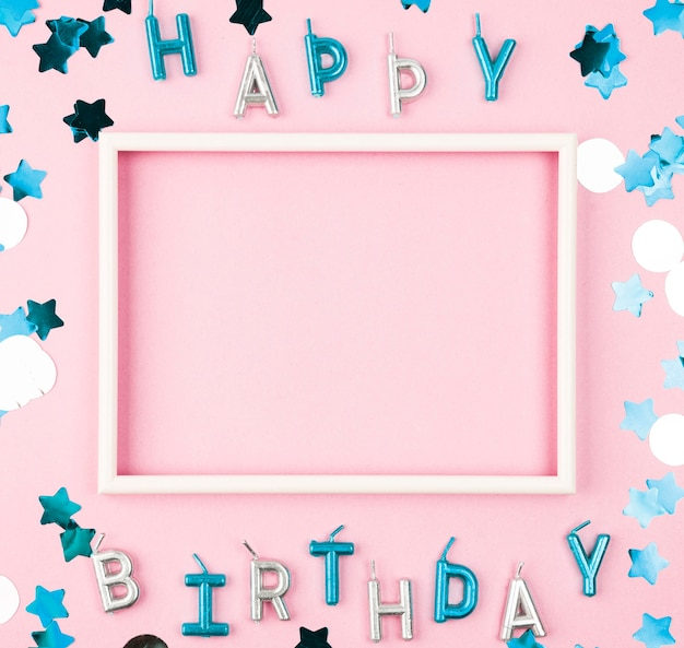 Top view happy birthday candles with frame