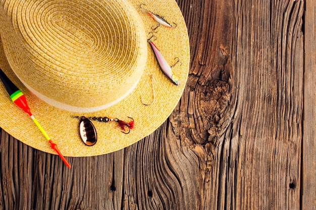 Top view of hat and other fishing essentials with copy space