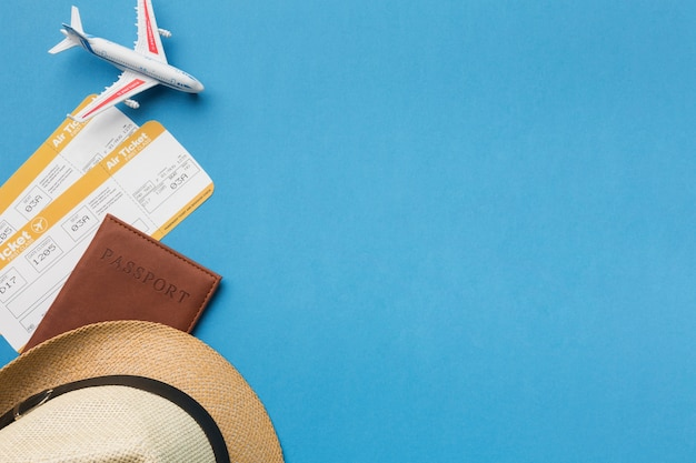 Top view of hat and travel essentials with copy space