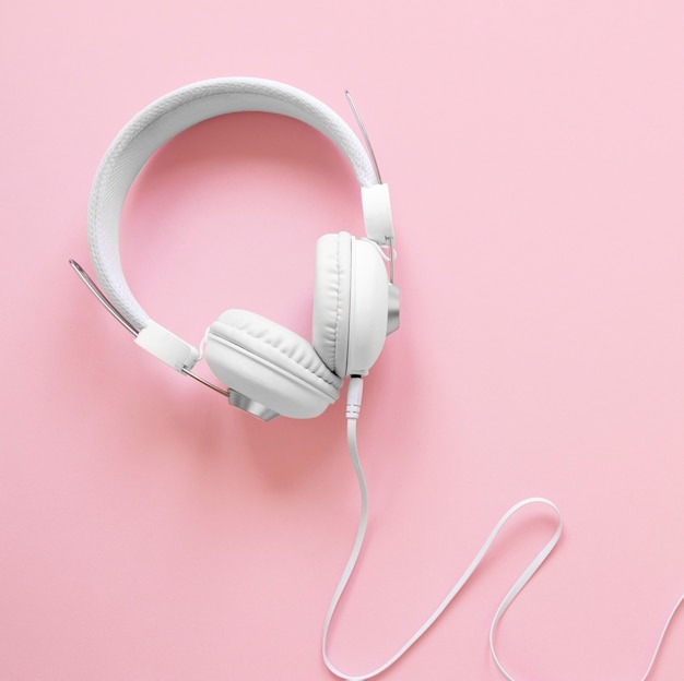 Top view headphones on pink background