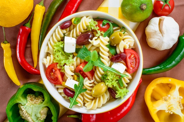 Top view of healthy and appetizing pasta salad
