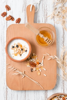 Top view healthy breakfast bowl with honey