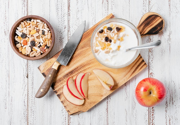 Top view healthy breakfast bowl with oats and apple