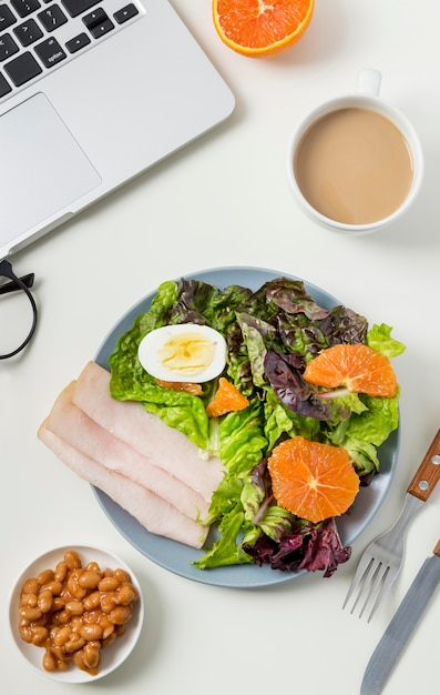 Top view healthy breakfast with lettuce and ham