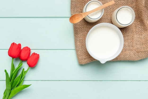 Top view healthy breakfast with tulips
