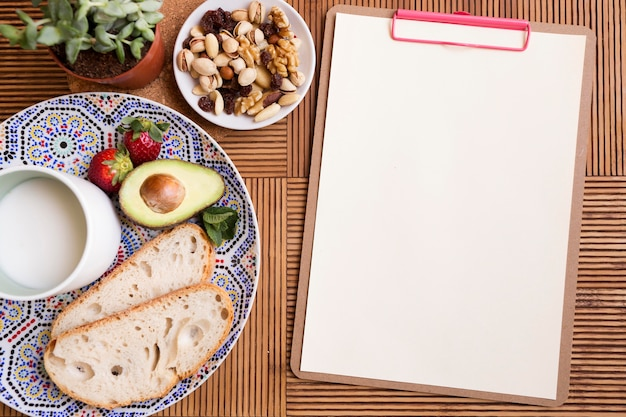 Top view healthy food and notepad