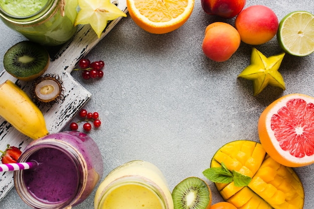 Top view healthy fruit smoothies frame