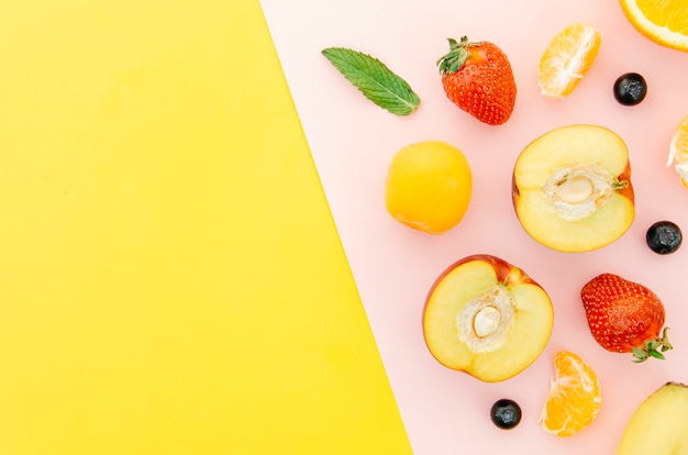 Top view healthy fruits with copy space