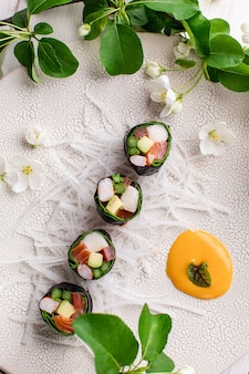 Top view of healthy japanese sushi roll without rice with crab meat wrapped in daikon radish high quality photo