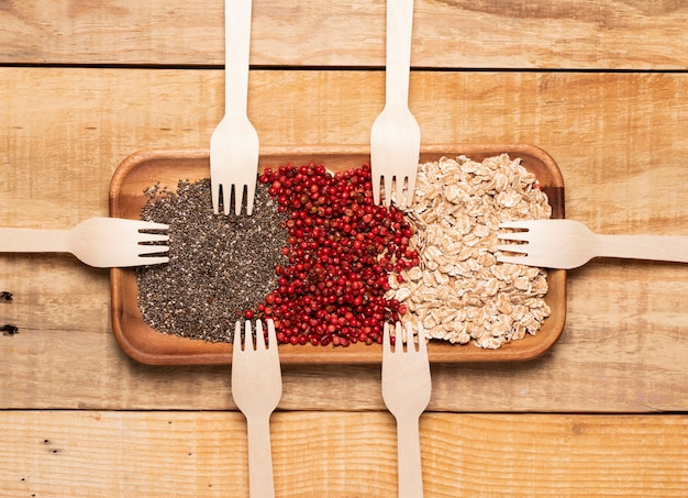 Top view healthy meal with wooden forks