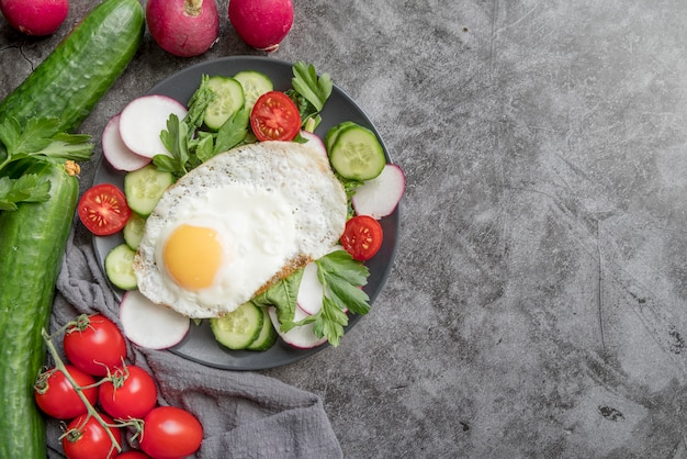 Top view healthy salad with vegetables and egg