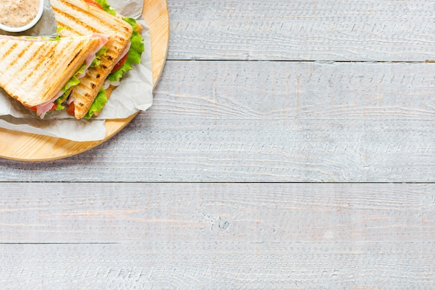 Top view of healthy sandwich toast on a wooden surface