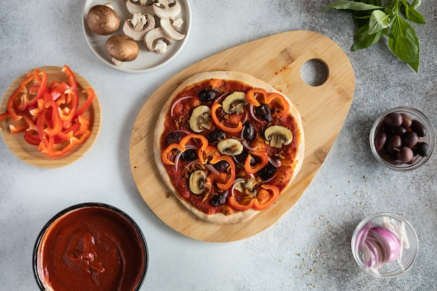 Top view of healthy vegan pizza with vegetables and mushrooms
