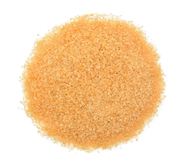 Top view of heap of brown sugar isolated on white