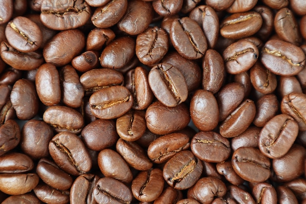 Top view of heap of roasted coffee beans for background or banner