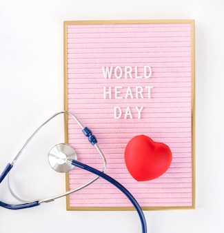 Top view of heart shape for world heart day with stethoscope