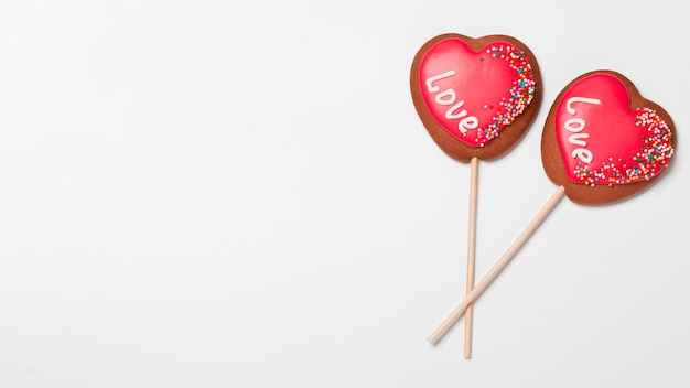 Top view of heart-shaped cookies on sticks