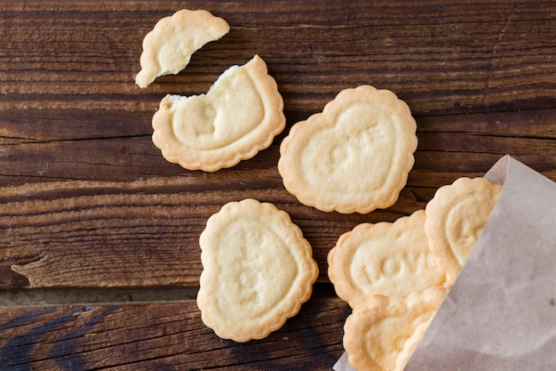 Top view of heart-shaped cookies on wooden background