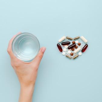 Top view heart shaped pills arrangement