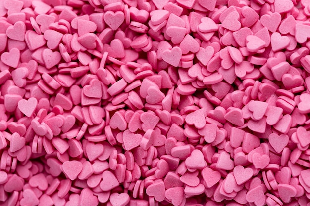 Top view of heart-shaped pink sweets