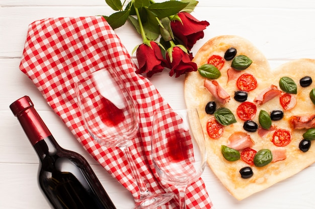 Top view heart shaped pizza dinner arrangement