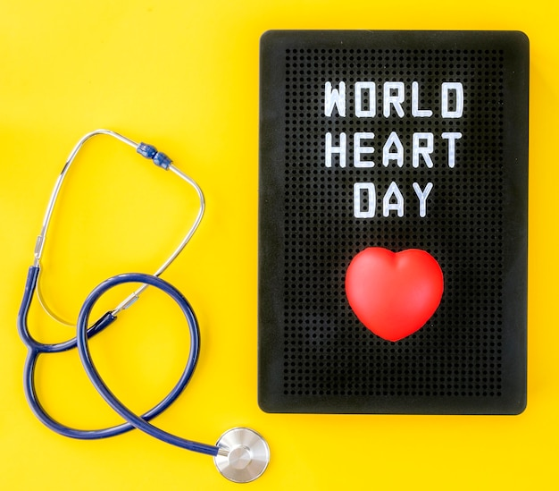 Top view of heart for world heart day with stethoscope