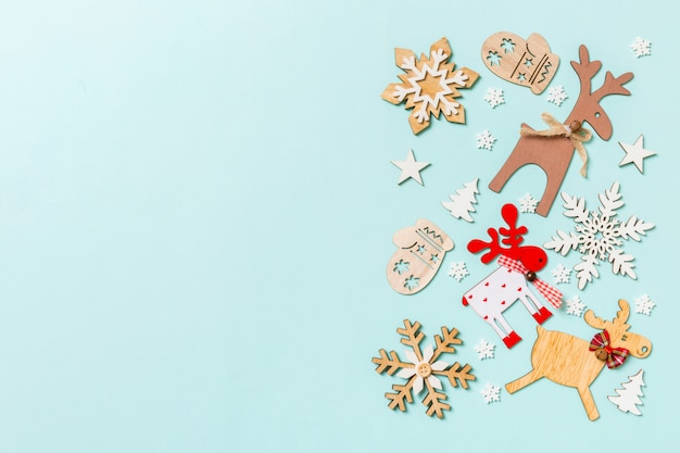 Top view of holiday decorations and toys on blue background. christmas ornament concept with empty space for your design
